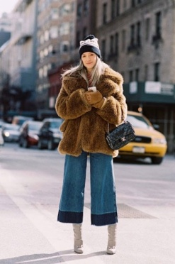 Charlotte Groeneveled keeps warm in NYC in her crops. Hoping it's a faux fur.